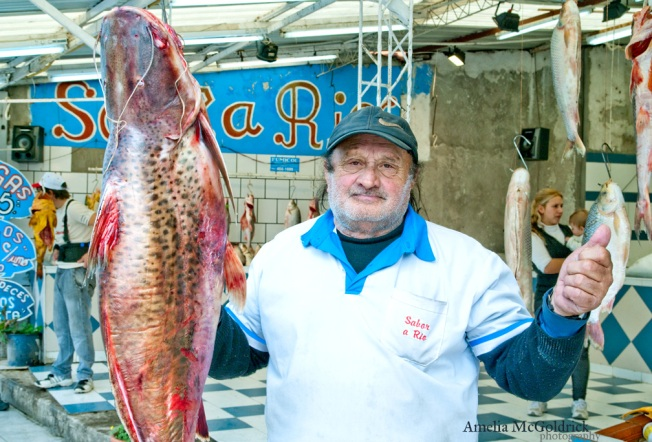 fish monger with huge river fish rosario argentina