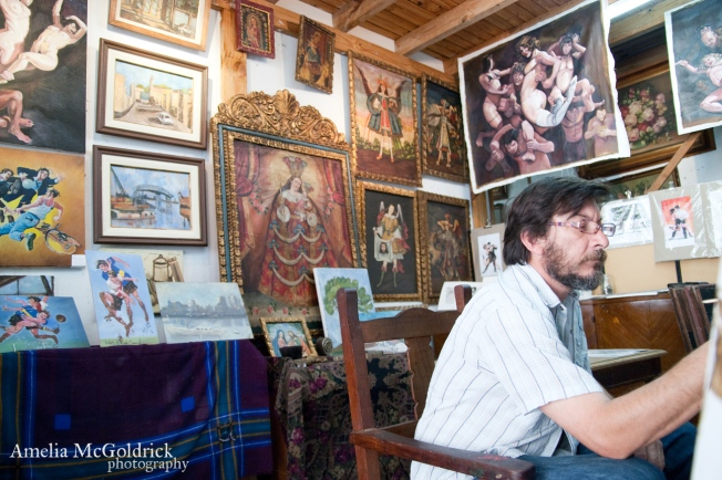 painter working with other paintings in background San Telmo, Buenos Aires Argentina