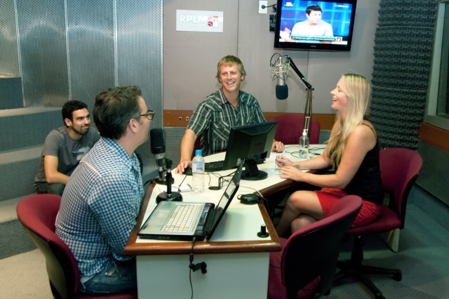 Radio program hosts laughing on air Buenos Aires Argentina The Typical Mistake