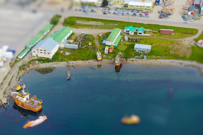 tilt shift, ariel view of boats in harbour, helicopter ride, Ushuaia, Argentina